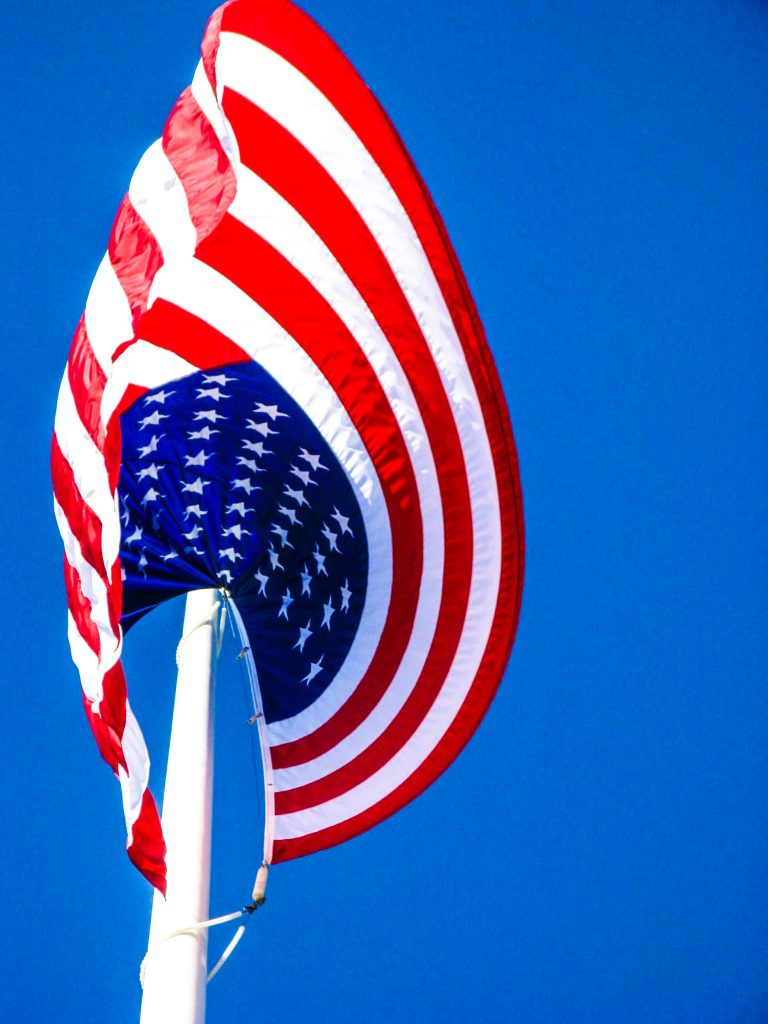 Brave-Heart-usa-flag-united-states-of-america-pole-white-sky-flying_edited