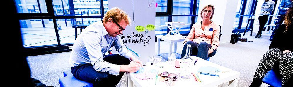 Design-Thinking-Group-Ideation-Workshop-Brainstorming-Working