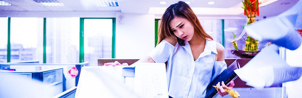 busy-lady-female-office-worker-chaos-paper-flying-around