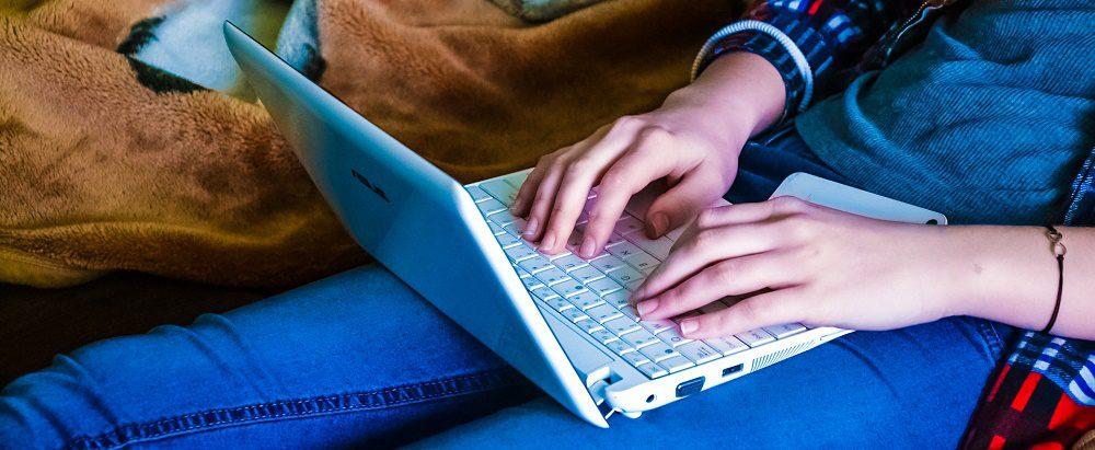 computer-woman-girl-using-laptop-lying-typing-working-watching-tv-internet