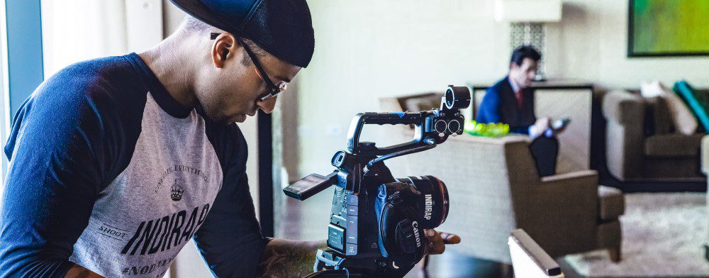 video-recording-camera-man-standing-operating-inside-movie-crop