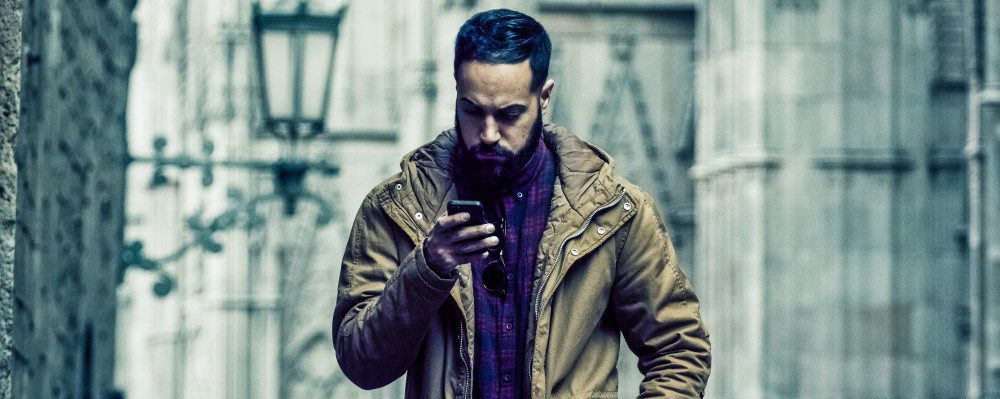 WhatsApp-Man-Walking-Texting-Looking-Down-App-Brazil-Cybersecurity-crop