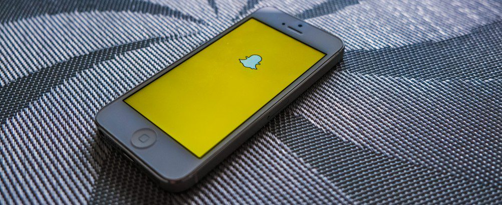 snapchat-photo-chat-app-lying-ghost-icon-yellow-screen-crop