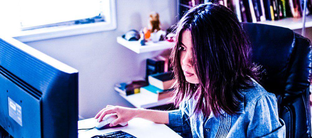 Woman Sitting Computer Desktop In Front of Screen Display Working Office Looking
