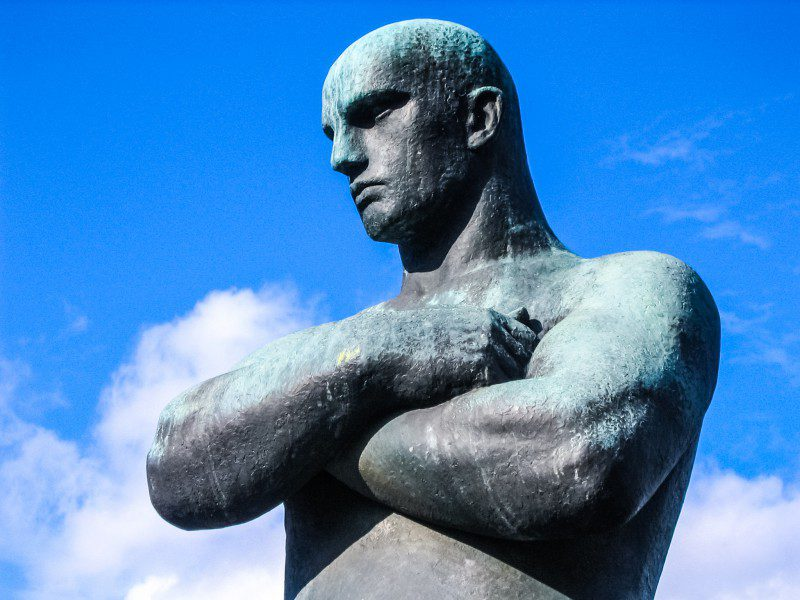 Crossed Arms Statue Sculpture Man Male Standing Looking Negative Emotions Blue Sky Clouds Collaborating With The Enemy Book Review Summary