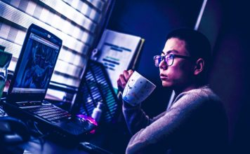 Man working from home laptop computer coffee morning productivity vdr virtual data rooms mna vc software security solution review guide info
