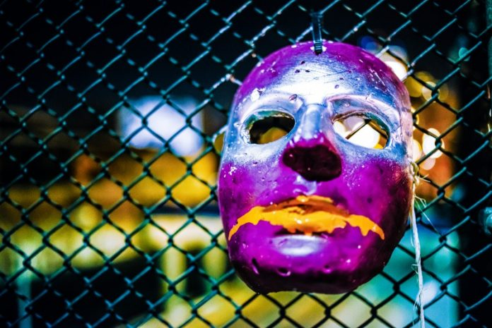 Mask InfoSec Hyper Realistic Article Japanese Facelock Apple Tech Security Access Management ID Authentification Hanging Purple Painted Fence