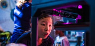 NASA Makerspace Hackerspace Event Child Watching 3D Printing in Awe Learning STEM Technology Events Engineering Education Young Girl Looking