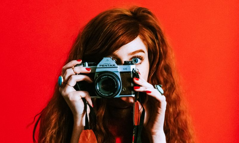 Photographer Photography Woman Taking Photos Pentax Camera Open Eyes Red Background