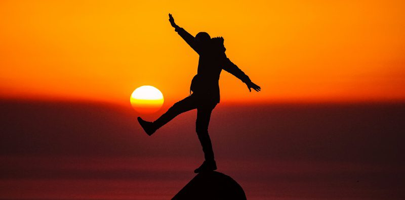 Balancing Happy Moments Silluette Shadow Outline Dancing Person Selective Focus Depth of Field Red Sunset Sky Sun Skies Risk Neutrality Bad Good Chance Opportunity Issue Problem Management Leadership