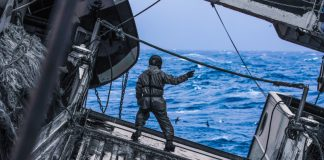 Man on Fishing Boat Vessel Out Sea Windy Waves Birds Seagulls Blue Ocean Risk Neutrality Bad Good Chance Opportunity Issue Problem Management Leadership