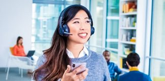 bluetooth-headset-logitech-zone-wireless-woman-smiling-happy-worker-talking-modern-office-space-technology-crop