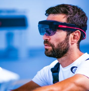Male Worker Using Lenovo ThinkReality A6 AR Headset Enterprise Industrial Technology Augmented Reality Mixed VR