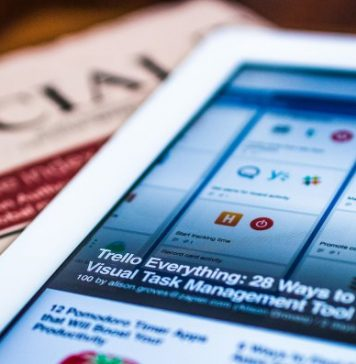 Tablet Lying On Newspaper Smartphone Tech Replacing Computers Article