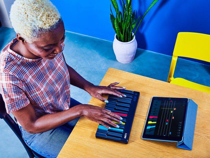 Lumi roli midi keyboard modular design for music learners woman playing with ipad app
