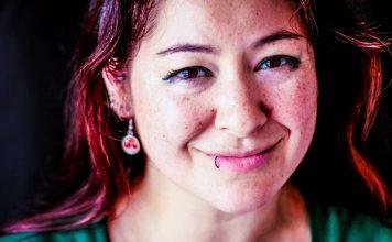 Ari Meisel The Replaceable Founder In A Nutshell Article Woman Looking Happy Smile Earrings Piercing