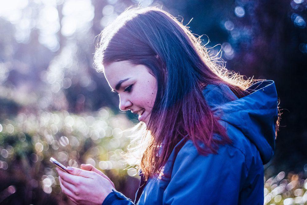 Young Woman Using Smartphone Girl Online Internet Digital Social Media ID Footprint Post
