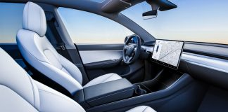 Tesla Uses Advanced AI to Innovate Self-Driving Cars Model Y White Interior