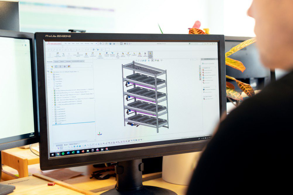 Male design engineer designs vertical farming solutions