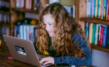 CodeGuppy Young Woman Child Girl Learning To Code Online Sitting Desk Working Smiling Happy