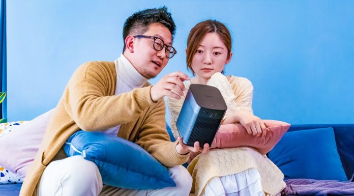 XGIMI Halo Projector Review Man Woman Checking Out New Product For Home Entertainment