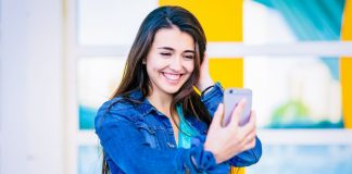 How to Keep Your Instagram Account Safe and Secure - Smiling Woman Using Smartphone For Selfie
