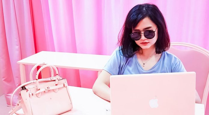 Shopify Apps for Shoppable Instagram Feeds in 2021 - Female Influencer Working On Laptop
